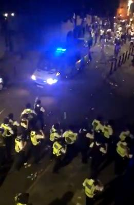 Screen grab from Twitter footage of a violent confrontation with police that took place in Brixton (Twitter/PA)