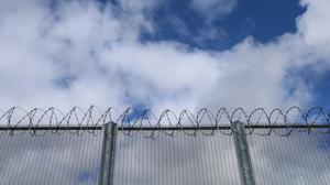 The report claimed most young adults are held in adult prisons without any coherent strategy (Niall Carson/PA)