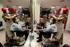 Ms Rickaby said she was happy to be able to give people a mental health boost by being back in the salon (Jonathan Brady/PA)