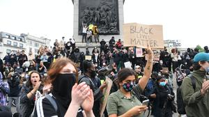 People participate in a Black Lives Matter protest rally in Trafalgar Square (Kirsty O'Connor/PA)