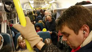 Commuters forced to stand on a Southern Railway train to London Victoria station