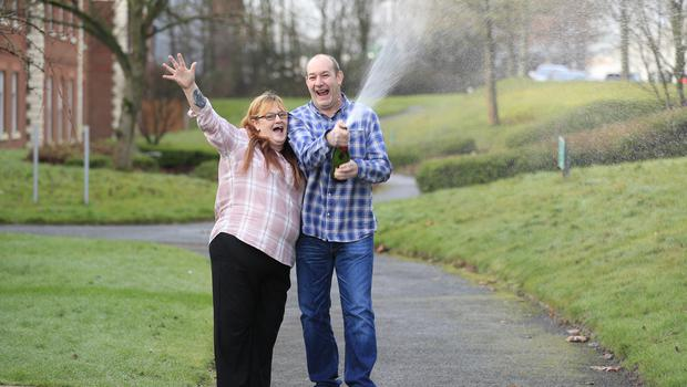 Malcolm and Bev Dixon celebrating their £1m lottery win at the Mercure Haydock Hotel in Haydock (Peter Byrne/PA)