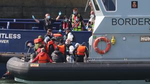 A group of people thought to be migrants are brought into Dover (Gareth Fuller/PA)