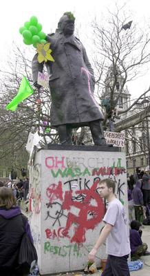The statue was covered by graffiti and a turf Mohican during an anti-capitalist demonstration in 2000 (John Stillwell/PA)