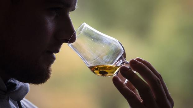 Washington will temporarily suspend tariffs on a range of goods, cutting the 25 per cent tariff rate on Scotch whisky to zero per cent for four months (Jane Barlow/PA)