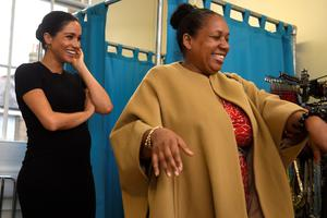 Meghan picks out clothes with Patsy Wardally during a visit to Smart Works (Clodagh Kilcoyne/PA)