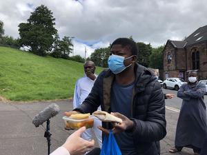 Asylum seeker Mohamed shows a meal he was served at the Tartan Lodge (PA)