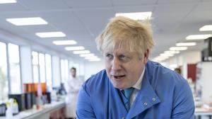 Prime Minister Boris Johnson during a visit to the Mologic Laboratory in the Bedford technology Park in Bedfordshire in early March (PA)