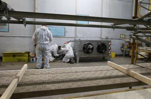 Refrigeration units are installed within the temporary mortuary, which was previously an NHS warehouse (Andrew Milligan/PA)