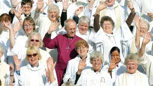 Archbishop of Canterbury Justin Welby joins women clerics on the steps of St Paul's Cathedral to mark the 20th anniversary of the ordination of the Church of England's first female priests