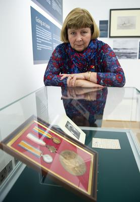 Kathreen Hunter, granddaughter of Norman Macleod with his medals, death plaque and a letter (Warren Media)