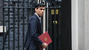 The IFS has said Rishi Sunak's emergency Plan for Jobs to tackle the coronavirus crisis will involve up to £10bn less spending on previously planned projects (Stefan Rousseau/PA)