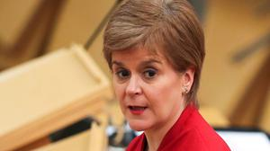 First Minister Nicola Sturgeon makes a statement to the Scottish Parliament in Holyrood, Edinburgh, setting out the Scottish Government's route map out of the current national lockdown (Russell Cheyne/PA)