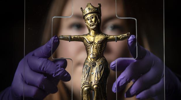 Curator of archeology at York Museums Trust Lucy Creighton with a rare 800-year-old figure of Christ (Danny Lawson/PA)