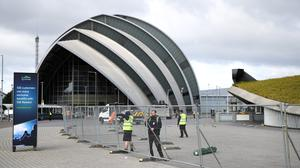 The Glasgow SEC, being converted to a coronavirus field hospital, was due to host Cop26 in November (Andrew Milligan/PA)
