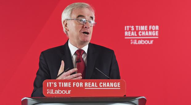 Shadow chancellor John McDonnell giving a speech on the economy in central London (David Mirzoeff/PA)