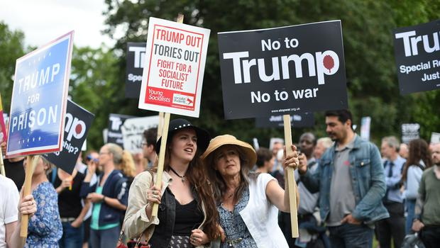 Protestors outside Buckingham Palace during the first day of Mr Trump's trip (David Mirzoeff/PA)