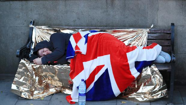 40 winks: One eager fan snatches a nap before the proceedings get under way (Mike Egerton/PA)