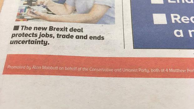 The newspapers have a small disclaimer at the bottom. (Sarah Smith/PA)
