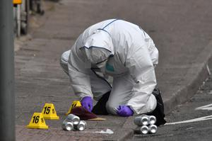 A forensic officer at the scene (Ben Birchall/PA)
