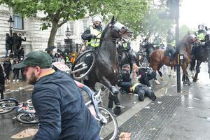 Bikes were thrown at mounted police during the clashes (Yui Mok/PA)