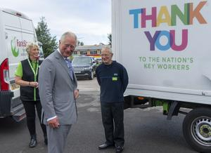 Charles with Asda staff members (Arthur Edwards/The Sun/PA)