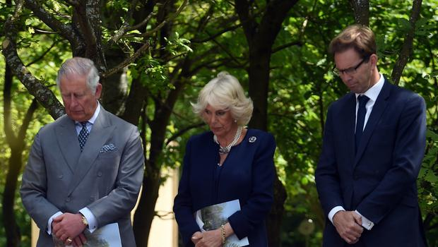 The Prince of Wales and Duchess of Cornwall with Defence Minister Tobias Ellwood during a dedication service for the National Memorial to British Victims of Overseas Terrorism at The National Memorial Arboretum in Staffordshire. (Paul Ellis/PA)