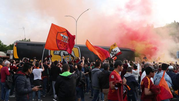 Roma fans surround their team's bus as it arrives at the Stadio Olimpico (Steve Parsons/PA)