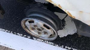 The car was being driven with no tyre (Tayside Police/PA)