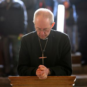 The Archbishop of Canterbury Justin Welby prays