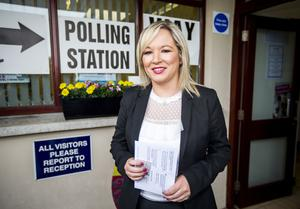 Sinn Fein leader in Northern Ireland Michelle O'Neill arrives at a polling station at St Patrick's primary school in Annaghmore, Clonoe (Liam McBurney/PA)