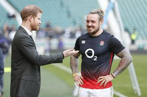 Prince Harry talks tactics with England player Jack Nowell (Heathcliff O'Malley/The Daily Telegraph/PA)