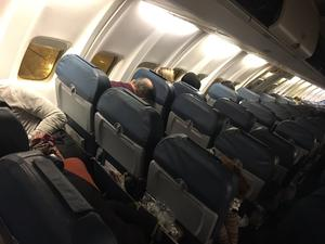 The scene inside a plane from Kiev after it landed at Birmingham having been diverted from Gatwick (@Christopher Lister/PA)