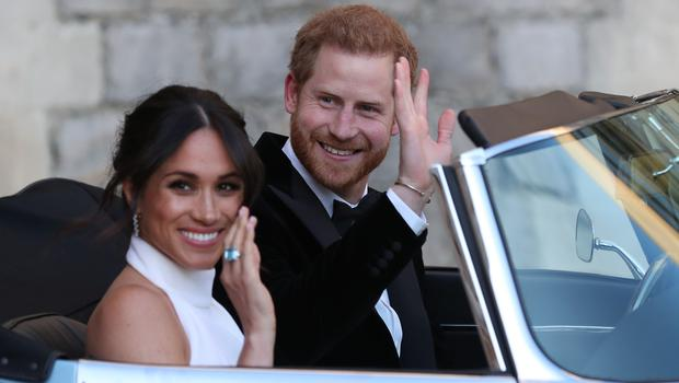 The newly married Duke and Duchess of Sussex on their way to the evening reception (Steve Parsons/PA)