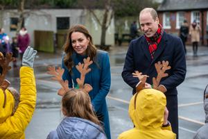 Some of the pupils wore reindeer antlers for the royal visit (Andy Commins/Daily Mirror/PA)
