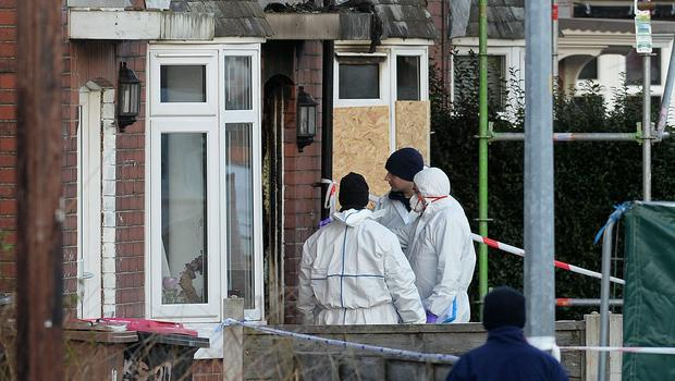 Forensic officers at the scene of a house fire on Jackson Street (Peter Byrne/PA)