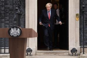 Prime Minister Boris Johnson makes a statement outside 10 Downing Street (Stefan Rousseau/PA)