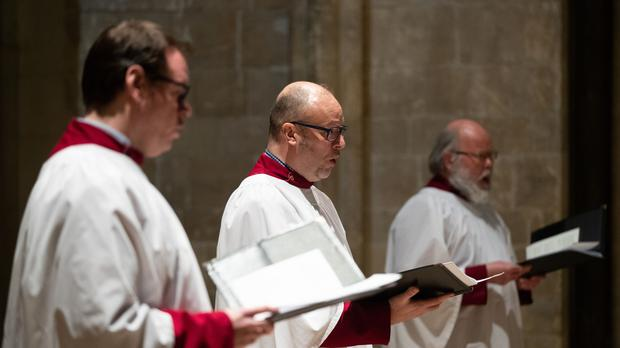 The choir sing during an Ash Wednesday service at Chichester Cathedral in West Sussex (PA)