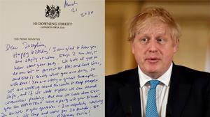 Mr Johnson sent a written reply to a note shared with him on Twitter (@BorisJohnson/Twitter and Leon Neal/PA)