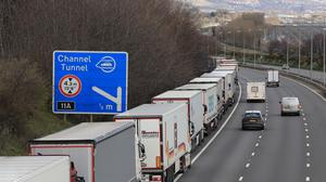 Lorries queue on the M20 outside Dover in Kent (Gareth Fuller/PA)