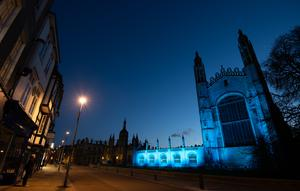 King's College at Cambridge University is bathed in blue light to salute local health service heroes (Joe Giddens/PA)