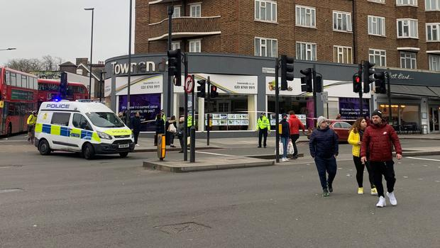Police at the scene in Streatham High Road (Isobel Fordsham/PA)