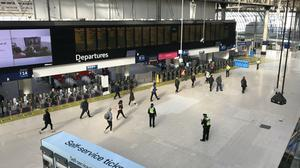 Commuters at Waterloo Station in London during rush hour on Monday morning (Luke Powell/PA)