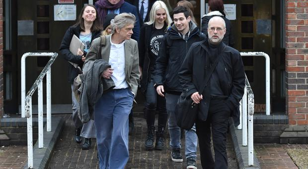 Jordi Casamitjana (front right) leaves an employment tribunal in Norwich (Nick Ansell/PA)