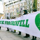 Protesters outside the Grenfell Tower public inquiry in London (Kirsty O'Connor/PA)