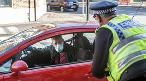 Police at a vehicle checkpoint in York where officers from North Yorkshire Police were ensuring that motorists and their passengers are complying with Government restrictions (PA)