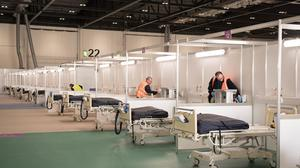 Soldiers and private contractors help to prepare the ExCel centre, London, which is being made into the temporary NHS Nightingale hospital, (Stefan Rousseau/PA)