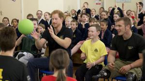 Prince Harry takes part in a game during the filming of an episode of the Sky Sports 'Game Changers' television show dedicated to the Invictus Games at Lambs Lane Primary School in Spencers Wood, near Reading.