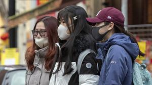 Many people have been spotted wearing face masks amid the outbreak (Peter Byrne/PA)