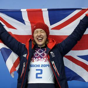 "Lizzie Yarnold said she was ""chuffed"" to be crowned Britain's 10th ever winter Olympics champion after winning gold in the women's skeleton (AP)"